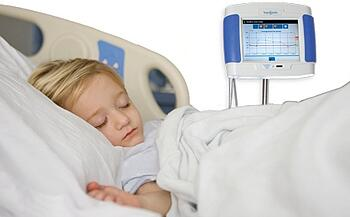 Child with hemodialysis monitor