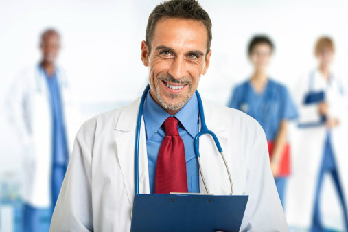 smiling-doctor-in-front-of-team.jpg